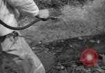 Image of man with container on his back Caracas Venezuela, 1940, second 50 stock footage video 65675050648