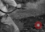 Image of man with container on his back Caracas Venezuela, 1940, second 51 stock footage video 65675050648