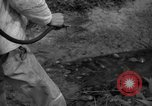 Image of man with container on his back Caracas Venezuela, 1940, second 52 stock footage video 65675050648