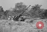 Image of Antiaircraft gunners throw off camouflage and maneuver guns Hammond Louisiana USA, 1943, second 6 stock footage video 65675050733