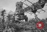 Image of Antiaircraft gunners throw off camouflage and maneuver guns Hammond Louisiana USA, 1943, second 30 stock footage video 65675050733