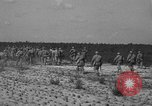 Image of Troops of 55th Brigade AAA train in ground defense tactics Hammond Louisiana USA, 1943, second 59 stock footage video 65675050738