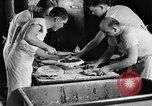 Image of bakeshop on Navy ship Tacoma Washington USA, 1930, second 35 stock footage video 65675050770