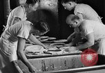 Image of bakeshop on Navy ship Tacoma Washington USA, 1930, second 36 stock footage video 65675050770