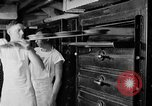 Image of bakeshop on Navy ship Tacoma Washington USA, 1930, second 49 stock footage video 65675050770