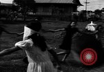 Image of Filipino people during Japanese occupation Manila Philippines, 1942, second 46 stock footage video 65675050781