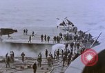 Image of USS Enterprise severely damaged by Kamikaze strike Pacific Ocean, 1945, second 57 stock footage video 65675050835