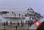 Image of USS Enterprise severely damaged by Kamikaze strike Pacific Ocean, 1945, second 58 stock footage video 65675050835