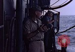 Image of U.S. Navy TBF Avenger aircraft drop practice bombs on target sled Pacific Ocean, 1945, second 47 stock footage video 65675050838