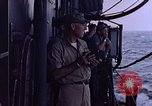 Image of U.S. Navy TBF Avenger aircraft drop practice bombs on target sled Pacific Ocean, 1945, second 49 stock footage video 65675050838