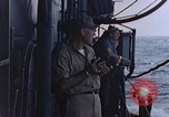 Image of U.S. Navy TBF Avenger aircraft drop practice bombs on target sled Pacific Ocean, 1945, second 54 stock footage video 65675050838