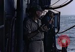 Image of U.S. Navy TBF Avenger aircraft drop practice bombs on target sled Pacific Ocean, 1945, second 55 stock footage video 65675050838