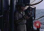 Image of U.S. Navy TBF Avenger aircraft drop practice bombs on target sled Pacific Ocean, 1945, second 56 stock footage video 65675050838