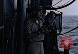 Image of U.S. Navy TBF Avenger aircraft drop practice bombs on target sled Pacific Ocean, 1945, second 58 stock footage video 65675050838