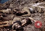 Image of dead bodies Tinian Island Mariana Islands, 1944, second 58 stock footage video 65675050848