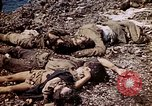 Image of dead bodies Tinian Island Mariana Islands, 1944, second 59 stock footage video 65675050848