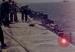Image of F6F Hellcat aircraft on fire Pacific Ocean, 1945, second 38 stock footage video 65675050861