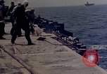 Image of F6F Hellcat aircraft on fire Pacific Ocean, 1945, second 39 stock footage video 65675050861