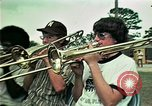 Image of Vietnamese refugees listen to music Florida United States USA, 1975, second 1 stock footage video 65675050947