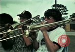 Image of Vietnamese refugees listen to music Florida United States USA, 1975, second 2 stock footage video 65675050947