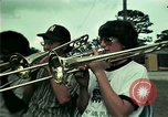 Image of Vietnamese refugees listen to music Florida United States USA, 1975, second 3 stock footage video 65675050947