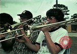 Image of Vietnamese refugees listen to music Florida United States USA, 1975, second 6 stock footage video 65675050947
