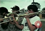 Image of Vietnamese refugees listen to music Florida United States USA, 1975, second 7 stock footage video 65675050947