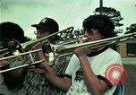 Image of Vietnamese refugees listen to music Florida United States USA, 1975, second 8 stock footage video 65675050947