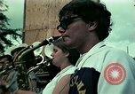 Image of Vietnamese refugees listen to music Florida United States USA, 1975, second 10 stock footage video 65675050947