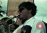 Image of Vietnamese refugees listen to music Florida United States USA, 1975, second 15 stock footage video 65675050947
