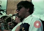 Image of Vietnamese refugees listen to music Florida United States USA, 1975, second 17 stock footage video 65675050947