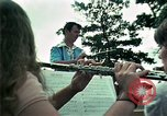 Image of Vietnamese refugees listen to music Florida United States USA, 1975, second 18 stock footage video 65675050947