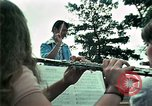 Image of Vietnamese refugees listen to music Florida United States USA, 1975, second 19 stock footage video 65675050947