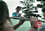 Image of Vietnamese refugees listen to music Florida United States USA, 1975, second 20 stock footage video 65675050947