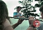 Image of Vietnamese refugees listen to music Florida United States USA, 1975, second 21 stock footage video 65675050947