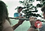 Image of Vietnamese refugees listen to music Florida United States USA, 1975, second 22 stock footage video 65675050947