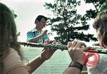 Image of Vietnamese refugees listen to music Florida United States USA, 1975, second 23 stock footage video 65675050947