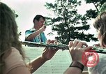 Image of Vietnamese refugees listen to music Florida United States USA, 1975, second 24 stock footage video 65675050947