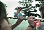 Image of Vietnamese refugees listen to music Florida United States USA, 1975, second 26 stock footage video 65675050947