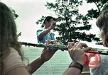 Image of Vietnamese refugees listen to music Florida United States USA, 1975, second 27 stock footage video 65675050947