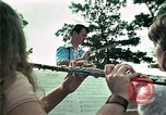 Image of Vietnamese refugees listen to music Florida United States USA, 1975, second 28 stock footage video 65675050947