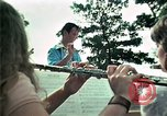 Image of Vietnamese refugees listen to music Florida United States USA, 1975, second 29 stock footage video 65675050947