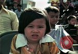 Image of Vietnamese refugees listen to music Florida United States USA, 1975, second 31 stock footage video 65675050947