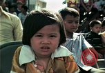 Image of Vietnamese refugees listen to music Florida United States USA, 1975, second 32 stock footage video 65675050947