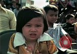 Image of Vietnamese refugees listen to music Florida United States USA, 1975, second 33 stock footage video 65675050947