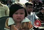 Image of Vietnamese refugees listen to music Florida United States USA, 1975, second 34 stock footage video 65675050947