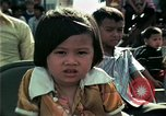 Image of Vietnamese refugees listen to music Florida United States USA, 1975, second 35 stock footage video 65675050947