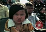 Image of Vietnamese refugees listen to music Florida United States USA, 1975, second 36 stock footage video 65675050947