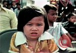 Image of Vietnamese refugees listen to music Florida United States USA, 1975, second 37 stock footage video 65675050947
