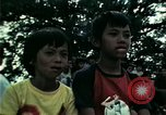 Image of Vietnamese refugees listen to music Florida United States USA, 1975, second 38 stock footage video 65675050947